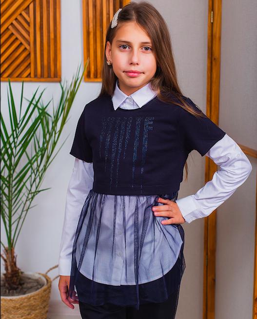 Блузки для дівчаток: базова річ в шкільному гардеробі